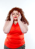 The big woman with red lipstick and large abdominal pain, bad mood Royalty Free Stock Photography