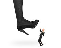 Big woman shoe stepping on an affaraid woman Stock Photos
