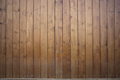 Big wooden barn gate. Monumental farm door, two timber leaf, closed brown gateway with planks and nails Royalty Free Stock Images