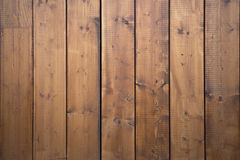 Big wooden barn gate. Monumental farm door, two timber leaf, closed brown gateway with planks and nails. Exterior country situation. Rural entry architecture Royalty Free Stock Images