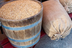 Grains in barrel and sacks Stock Image