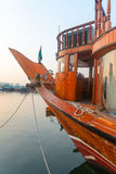 Big wooden boat moored up in a port Stock Images