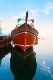 Big wooden cargo boat in blue water Royalty Free Stock Photo