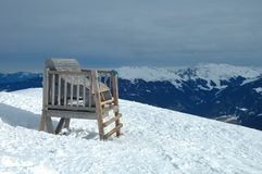 Big wooden chair in Alps in winter Stock Images