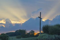 Big Wooden Cross On Green Grass Field Under The White Clouds Royalty Free Stock Photos
