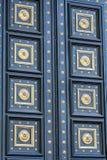 Big wooden  design door with golden ornaments Stock Photo