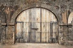Big wooden door in a rustic stud farm Royalty Free Stock Photo