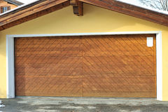 Garage with big wooden doors. Royalty Free Stock Photography