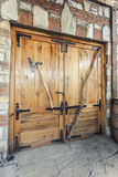 Big wooden double door on a stone house Stock Image