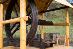 Big wooden draw well. Vintage Slavonic traditional big wooden draw well with huge wheel and bucket Stock Image