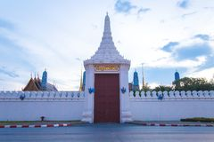 Big wooden gate with caption `Sawasdeeloke` of the Emerald Buddha or Wat Phra Kaew Temple a stock photography