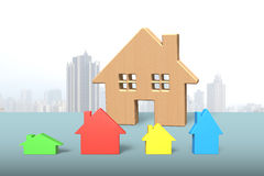 Big wooden house with four colorful small houses Royalty Free Stock Photo