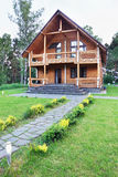 Big Wooden House Made of Logs Near of Forest Stock Photo