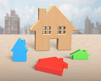 Big wooden house with three colorful small houses Stock Images