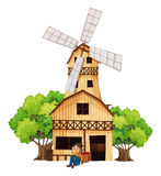 A big wooden house with a windmill Royalty Free Stock Images