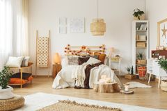 Wooden lampshade in bedroom Stock Photos