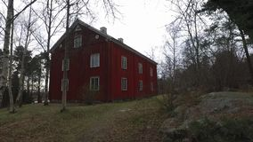 Big Wooden Red House. At Skansen in Stockholm, Sweden. Using of DJI Osmo for better stabilization and smooth motion stock footage