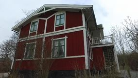 Big Wooden Red House. With white window frames at Skansen in Stockholm, Sweden. Using of DJI Osmo for better stabilization and smooth motion stock footage