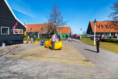 Big wooden shoe, clog or klomp for taking photos, Zaanse Schans village, Holland, tourists around Royalty Free Stock Image