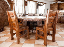 Big wooden table with chairs. Interior photo of big wooden table with chairs Stock Photography