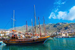 Big Wooden yacht anchored in port of Pothia, Kalymnos Stock Photos