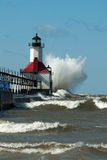 Big WOOSH! wave and michigan lighthouse Royalty Free Stock Photos