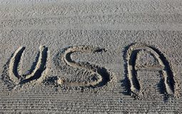 Big WORD USA United States of America on the sand. Of the beach stock photography