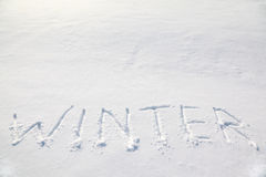 Big words winter on snow field Stock Image