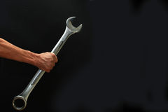 Big Wrench. Man holding a big steel wrench Stock Photos