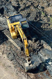 Excavator on the river bed. Top view. Royalty Free Stock Photography