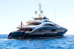 Big yacht, rear view, sails into the open sea royalty free stock image