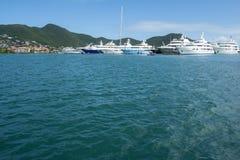 Big Yachts Anchored at a Bay in the Caribbean 1 Stock Image