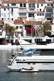 Big Yachts and Jet Bike in Puerto Banus Harbour. With Traditional Spanish Architecture in the Buildings Stock Photos