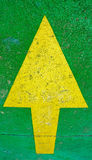 Big yellow arrow pointing up with green background Royalty Free Stock Images