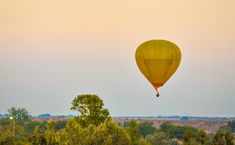 Big yellow balloon flying Stock Image