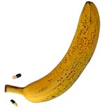 Big yellow banana with two pills Stock Photo