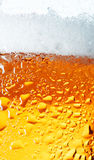 Big Yellow Bubbles. Close-up picture of a condensation on the glass of beer Royalty Free Stock Photo