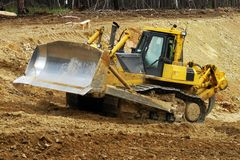 Bulldozer at construction site royalty free stock image