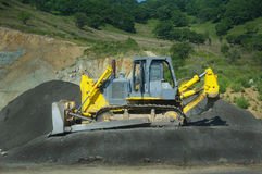 Big yellow bulldozer at work-site Royalty Free Stock Photo