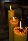 Big Yellow Candle in The Dark Royalty Free Stock Image