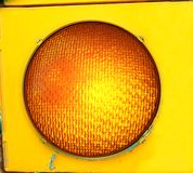 Big Yellow Caution Light. Extra Large yellow caution light glows in traffic signal at intersection Stock Images