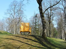 Big yellow chair in park, Lithuania Royalty Free Stock Image
