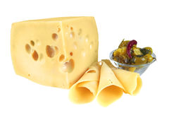 Big yellow cheese chunk and slices Royalty Free Stock Image