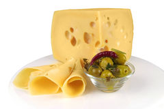 Big yellow cheese chunk and slices Stock Image