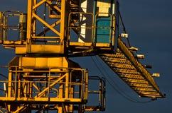 Big yellow construction crane against dark blue sky after rain in Belgrade Royalty Free Stock Photos
