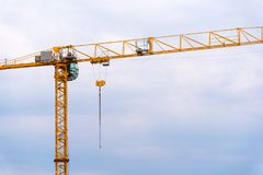 Big yellow crane. On a blue cloudy sky Royalty Free Stock Photos