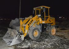 Big yellow dozer in the night. Transport royalty free stock images