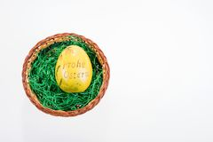 Big yellow egg with the inscription Happy Easter in german Stock Photo