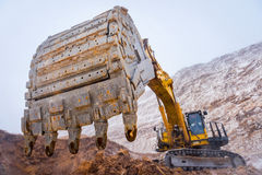 Big yellow excavator. At an open pit mining Royalty Free Stock Images
