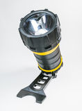 Big yellow flashlight hand held with adjustable angle isolated on white background.. Royalty Free Stock Image
